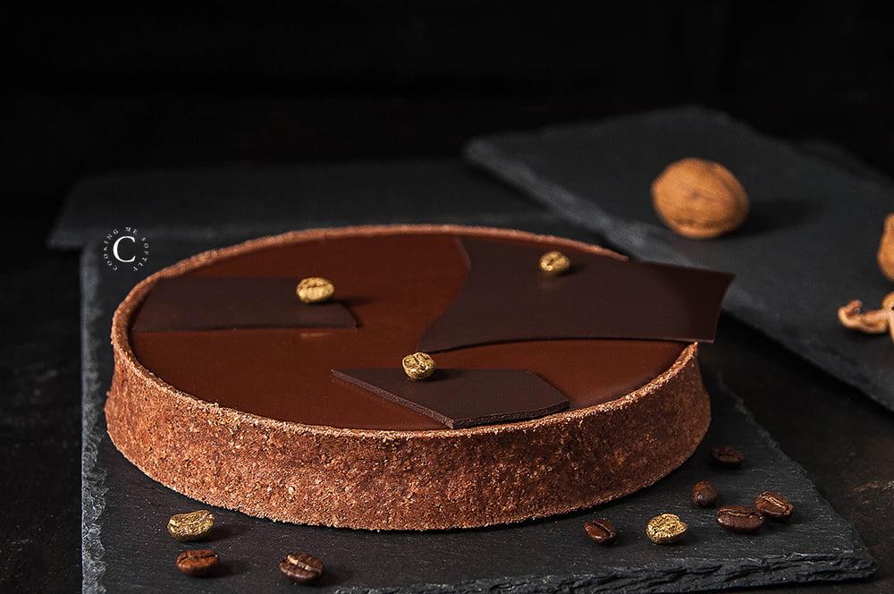 Crostata alle noci, caramello e cioccolato